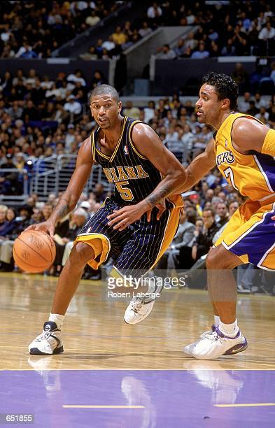 d815a05ad24 Jalen Rose of the Indiana Pacers dribbles the ball to the basket as he is  guarded. Rick Fox ...