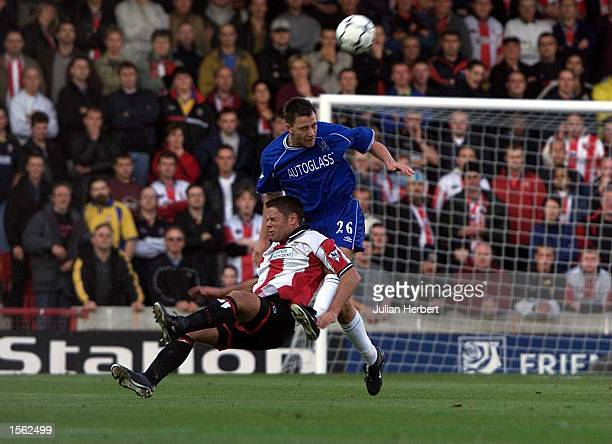 James Beattie of Southampton tangles with John Terry of Chelsea during the FA Carling Premier League match between Southampton v Chelsea at The Dell,...