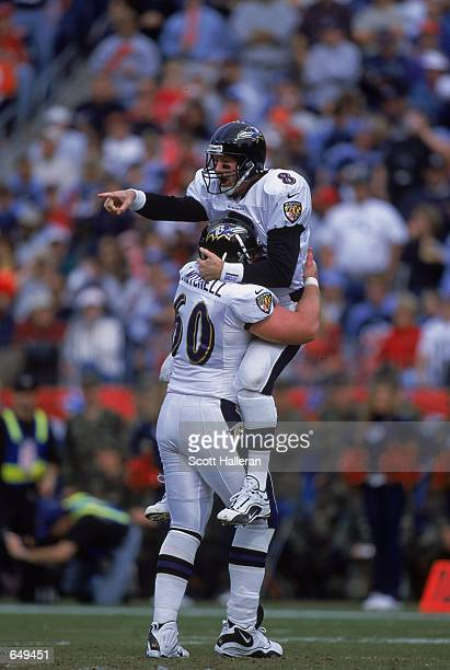 Jeff Mitchell of the Baltimore Ravens hugs Trent Dilfer during the game against the Tennessee Titans at the Adelphia Coliseum in Nashville Tennessee...