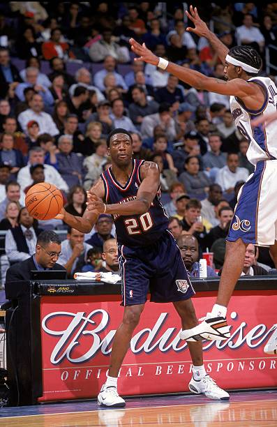 8 Nov 2000  Johnny Newman  20 of the New Jersey Nets passes the ball as he  is guarded by Richard Hamilton  32 of the Washington Wizards at the MCI  Center in ... f1af6938e