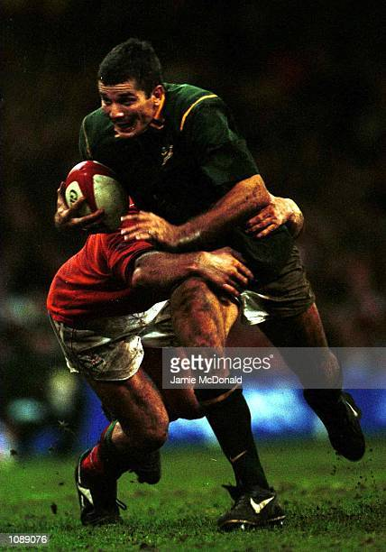 Joost van der Westhuizen of South Africa breaks the tackle of Ian Gough of Wales during the International match between Wales and South Africa at the...