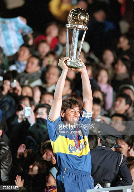 Jorge Bermudez Captain of Boca Juniors lifts the trophy after the victory over Real Madrid in the Toyota Intercontinental Cup in the National...