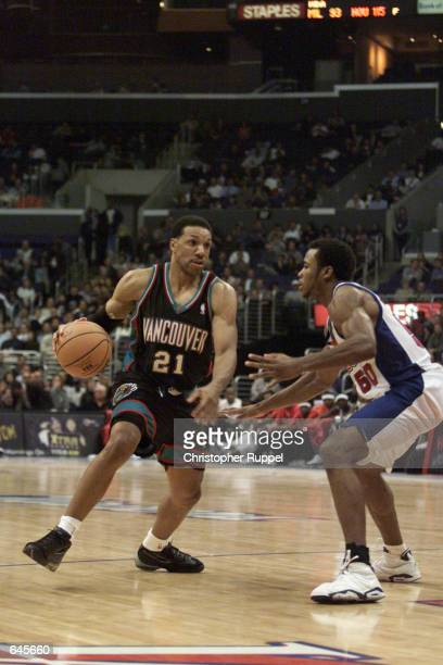 Kevin Edwards of the Vancouver Grizzlies advances against Corey Maggette of the Los Angeles Clippers during their game at Staples Center in Los...