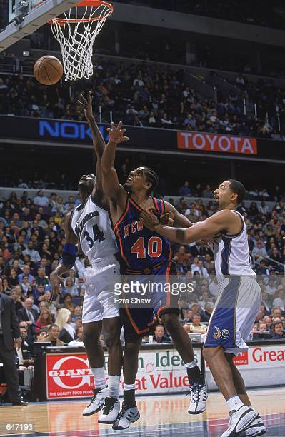 Kurt Thomas of the New York Knicks and Michael Smith of the Washington Wizards jump for the rebound during the game at the MCI Center in Washington...