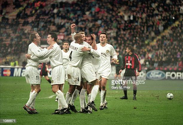 Leeds United celebrate taking the lead during the UEFA Champions League match against AC Milan played at the San Siro in Milan Italy The match ended...