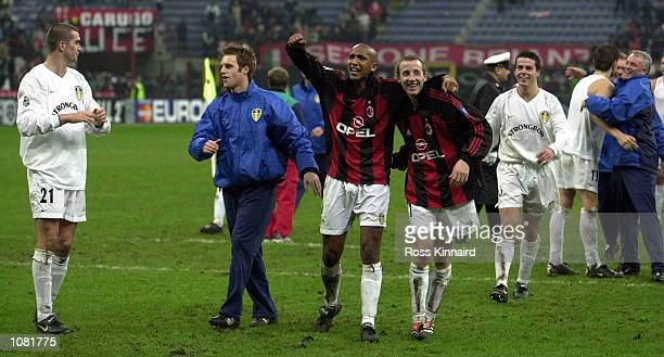 Leeds United celebrates after their victory in the AC Milan v Leeds United group ''H'' Champions League match at the San Siro Stadium in Milan Italy...