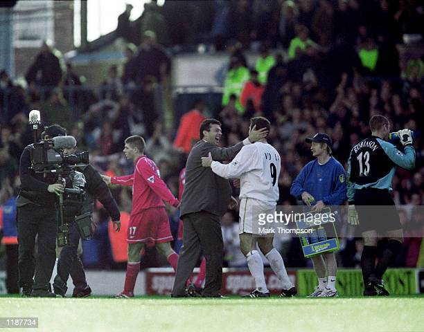 Leeds United manager David O''Leary celebrates with four goal marksmen Mark Viduka of Leeds United after the FA Carling Premiership match against...
