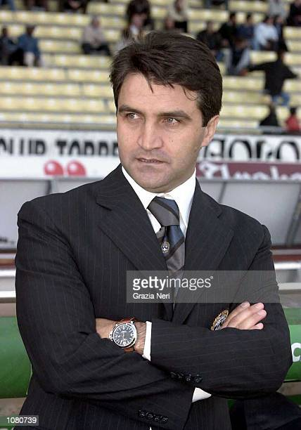Luigi De Canio manager of Udinese looks on during the Serie A League Round 5 match between Udinese and Lecce played at the Friuli Stadium in Udinese...