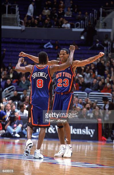 Marcus Camby and Latrell Sprewell of the New York Knicks celebrate with each other during the game against the Los Angeles Clippers at the STAPLES...
