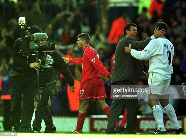 Mark Viduka of Leeds celebrates with manager David O''Leary the match between Leeds United and Liverpool in the FA Carling Premiership at Elland Road...