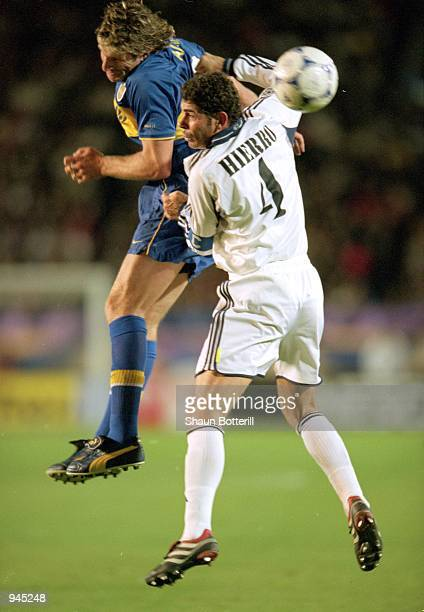 Martin Palermo of Boca Juniors and Fernando Hierro of Real Madrid clash during the Toyota Intercontinental Cup against Boca Juniors in the National...