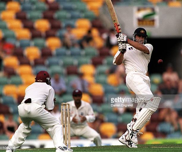 Matthew Hayden of Australia hits behind square leg during his innings of 44 against the West Indies during the first days play of the First Test...