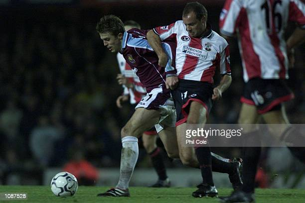 Michael Carrick of West Ham and Uwe Rosler of Southampton during the Carling Premiership match between Southampton and West Ham United at the Dell...
