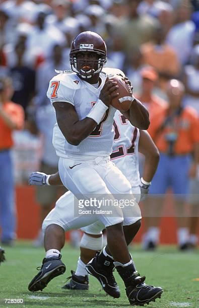 Michael Vick of the Virginia Tech Hokies drops back to pass the ball during the game against the Miami Hurricanes at the Orange Bowl in Miami,...