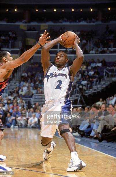 Mitch Richmond of the Washington Wizards moves to pass the ball during the game against the New York Knicks at the MCI Center in Washington DC The...