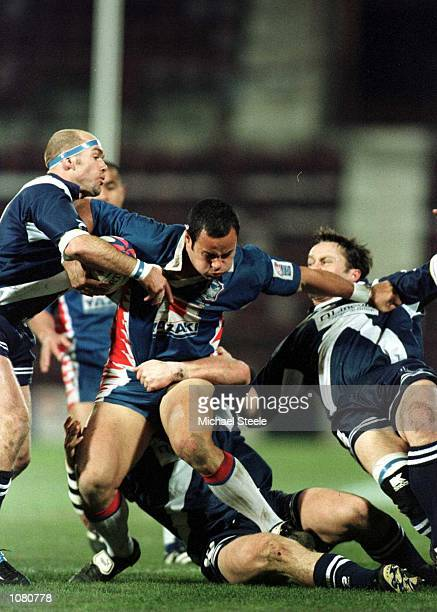Monty Betham of Samoa pushes through the Scotish defence during the Scotland v Western Samoa Rugby League World Cup match at Tynecastle Edinburgh...