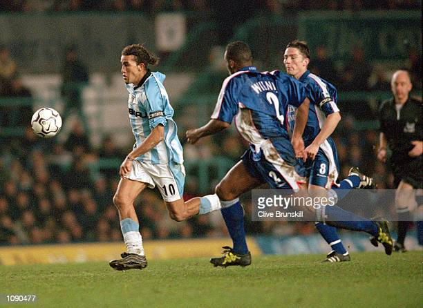 Moustapha Hadji of Coventry City takes on the Ipswich Town defence during the FA Carling Premiership match played at Highfield Road in Coventry...