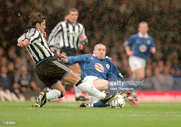 Muzzy Izzet of Leicester City clashes with Clarence Acuna of Newcastle United during the FA Carling Premiership match at Filbert Street in Leicester...