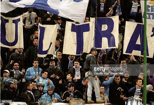Napoli fans cheer their team on during the Italian Serie A match against AC Milan played at the San Siro in Milan Italy AC Milan won the match 10...