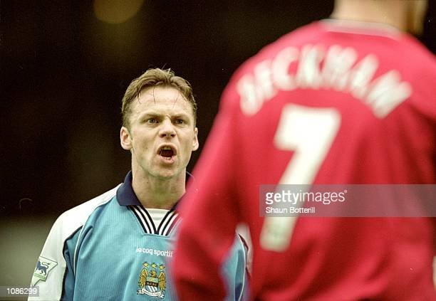 Paul Dickov of Manchester City argues with David Beckham of Manchester United during the FA Carling Premier League match played at Maine Road in...