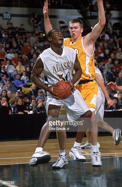 Peter Bullock of the Anchorage Alaska Seawolves gets ready to shoot the ball as Raitis Grafs of the Valparaiso Crusaders gaurds him during the Great...