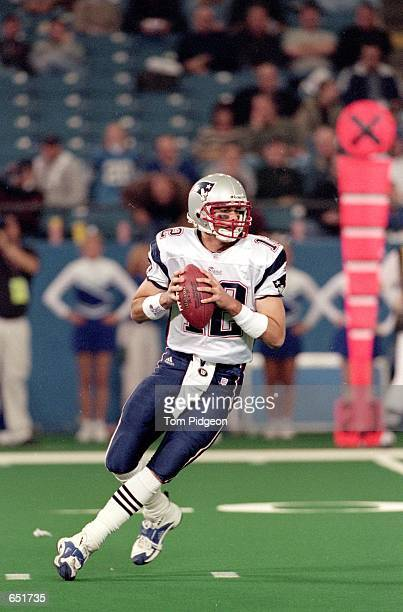 Quarterback Tom Brady of the New England Patriots moves back to pass the ball during the game against the Detroit Lions at the Pontiac Silverdome in...