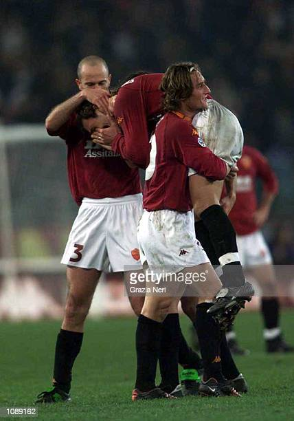 Roma players gather to celebrate Gabriel Omar Batistuta's goal during the Serie A 8th Round league match between Roma and Fiorentina played at the...