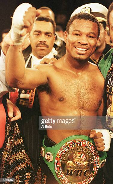Shane Mosley proudly wears his championship belt after he successfully defended his WBC Welterweight Title for the first time by knocking out...