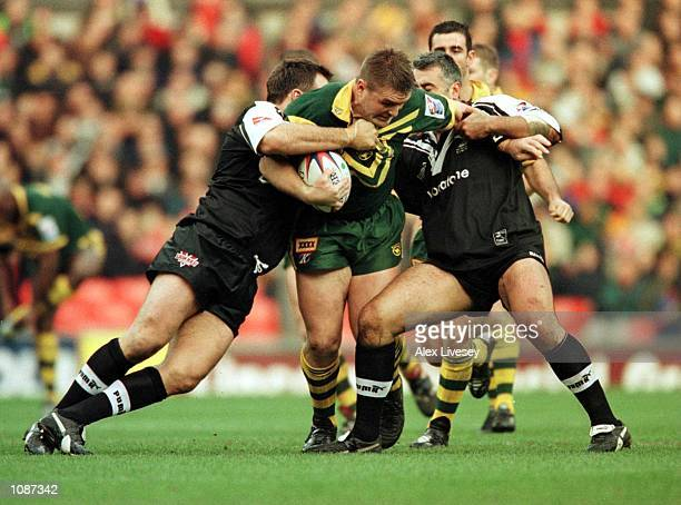 Shane Webcke of Australia is held up by the New Zealand defence during the Australia v New Zealand Rugby League World Cup Final at Old Trafford...