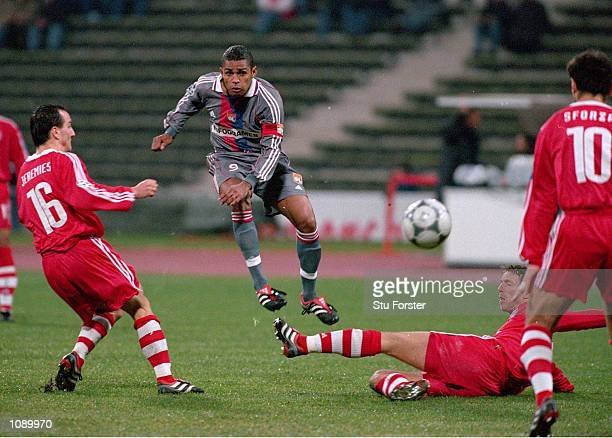 Sonny Anderson of Lyon has a shot during the UEFA Champions League match against Bayern Munich played at the Olympic Stadium in Munich Germany Bayern...
