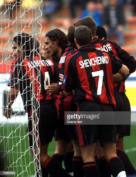 The AC Milan players celebrate scoring a goal during the Serie A League Round 5 match between AC Milan and Atalanta played at the San Siro Stadium in...