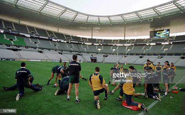 The Australian Rugby Union team Warm Up for Training prior to Saturday's match between France and Australia at the Stade de France Paris Mandatory...
