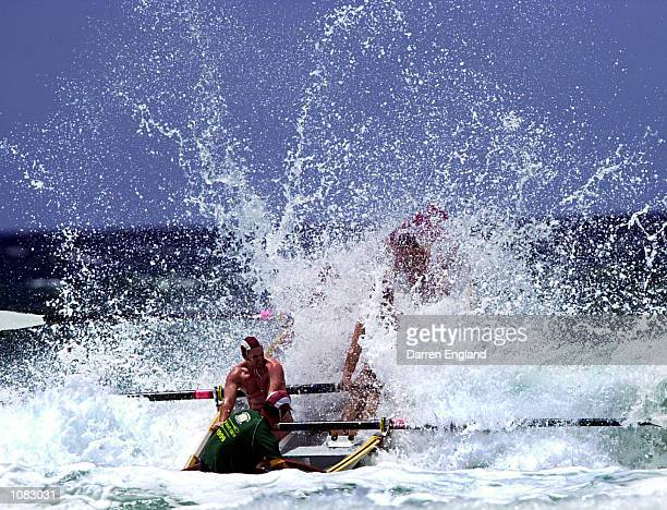 The Mooloolaba Surf Lifesaving club's Surf Boat crew crashes thru the waves during the heats of the mens open Surf Boat race during round two of the...