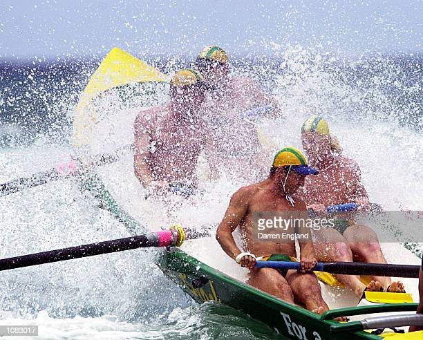 The Tugun Surf Lifesaving club's Surf Boat crew crashes thru the waves during the heats of the mens open Surf Boat race during round two of the XXXX...