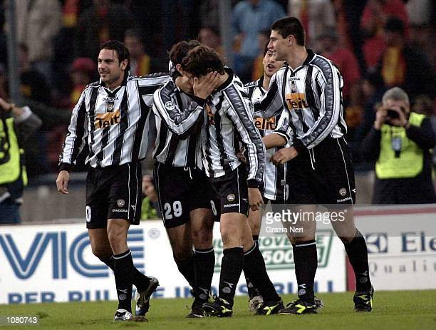 The Udinese players celebrate scoring a goal during the Serie A League Round 5 match between Udinese and Lecce played at the Friuli Stadium in...
