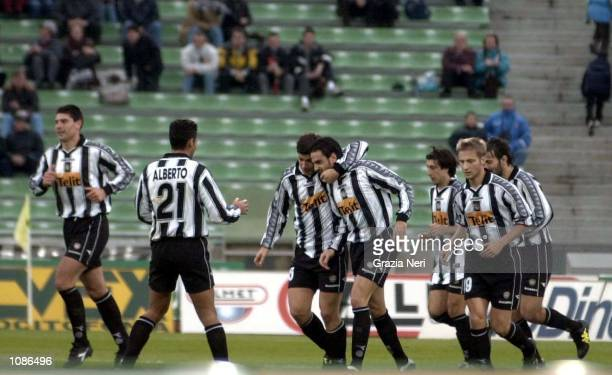 The Udinese players celebrate Sosa''a goal during the Serie A 7th round league match between Udinese and Reggina played at the Friuli stadium in...