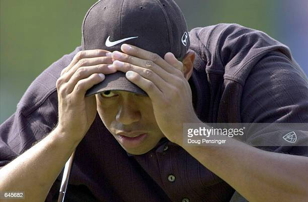 Tiger Woods eyes up a putt on the ninth hole during the second day of the PGA Tour Championship at East Lake Golf Club in Atlanta Georgia <<DIGITAL...