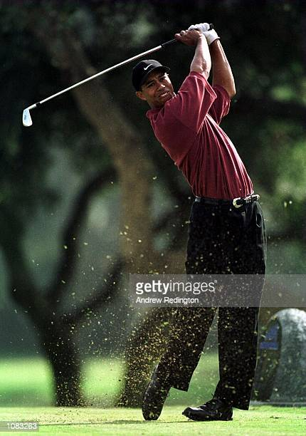 Tiger Woods of the United States hits his tee shot on the 2nd hole during the final round of the World Golf Championship at Valderrama Golf Club,...
