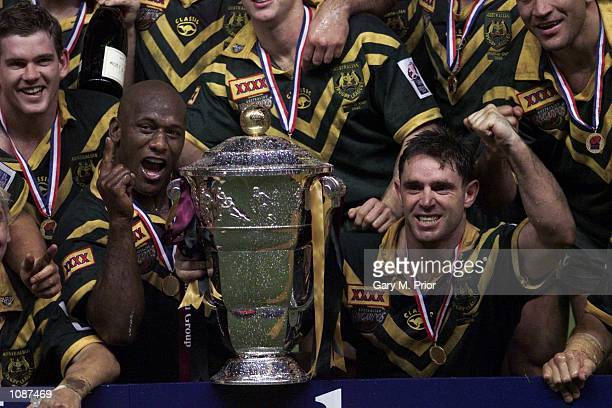Wendell Sailor and captain Brad Fittler celebrate with the trophy after winning the Australia v New Zealand Rugby League World Cup Final at Old...
