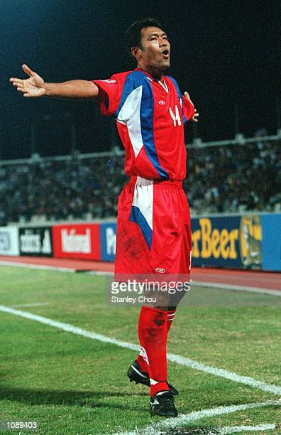 Worrawot Srimaka of Thailand celebrates scoring during the Thailand v Indonesia Tiger Cup match at Chiang Mai, Thailand. Mandatory Credit: Stanley...