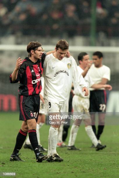 Zvonimir Boban of AC Milan shares a story with Mark Viduka of Leeds United after the UEFA Champions League match played at the San Siro in Milan...