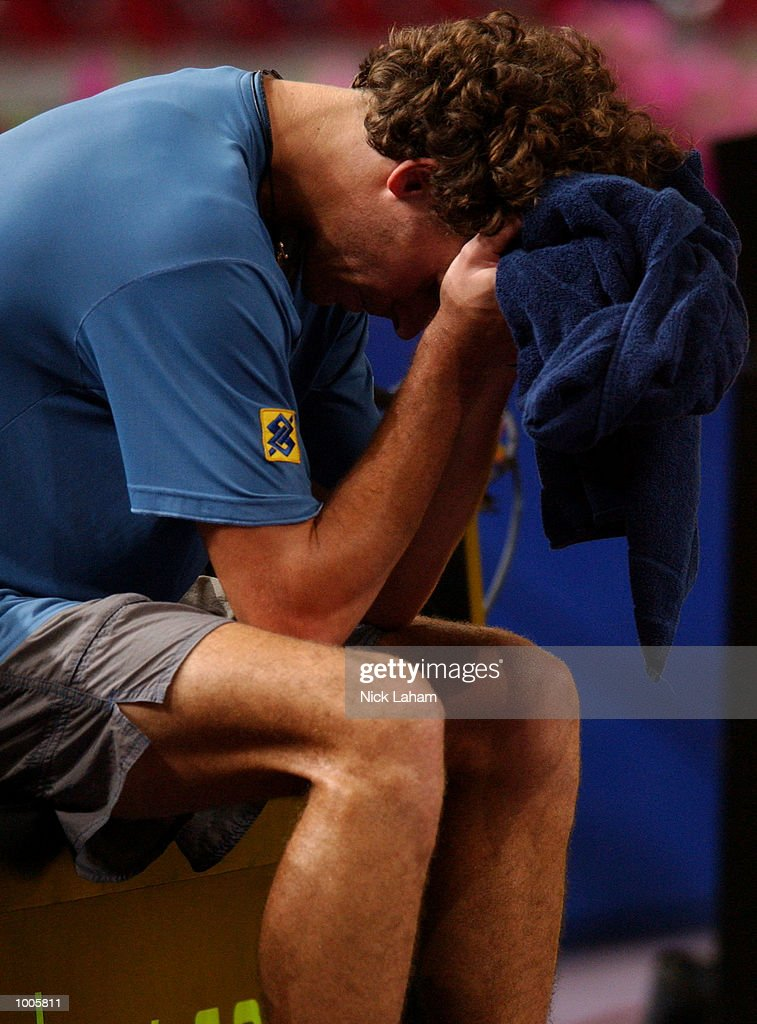 A dejected Gustavo Kuerten of Brazil during his match against Juan Carlos Ferrero of Spain during the Tennis Masters Cup held at the Sydney Superdome, Sydney, Australia. DIGITAL IMAGE Mandatory Credit: Nick Laham/ALLSPORT