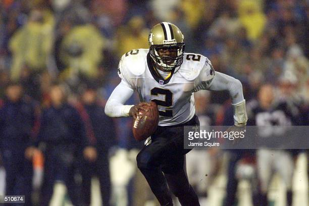 Aaron Brooks of the New Orleans Saints runs with the ball during the game at Foxboro Stadium in Foxboro Massachusettes The Patriots defeated the...