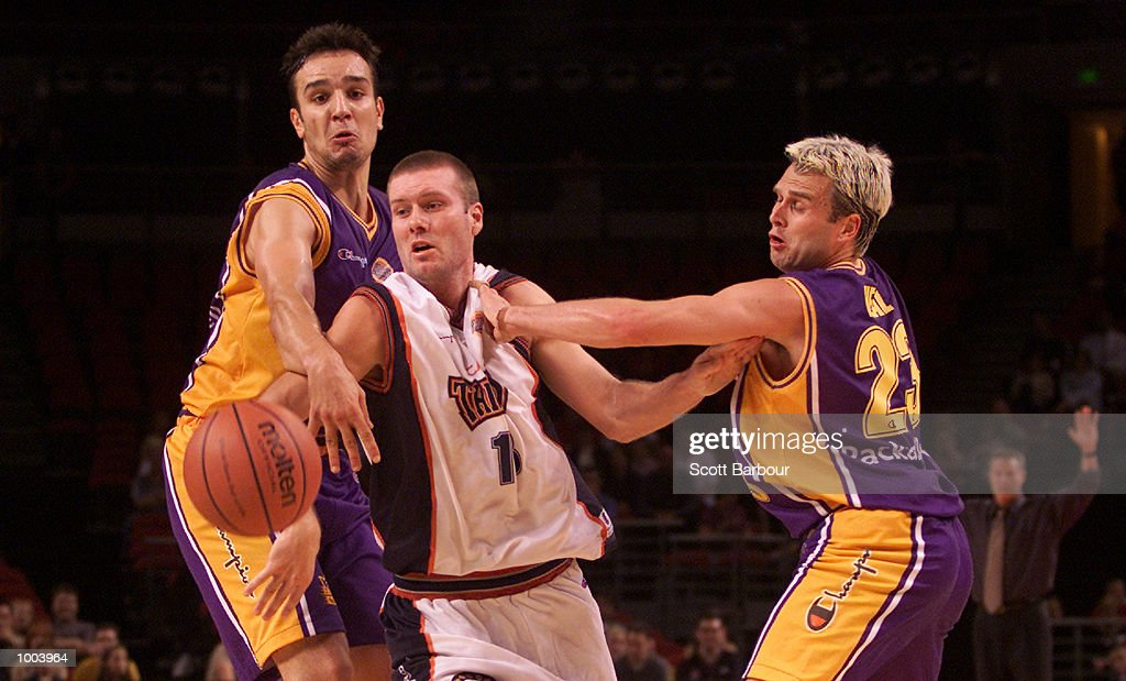 Aaron Trahair #13 of the Taipans is grabbed by Sahne Heal #23 (right) of the Kings during the Sydney Kings v Cairns Taipans match held at the Sydney Superdome in Sydney, Australia. DIGITAL IMAGE. Mandatory Credit: Scott Barbour/ALLSPORT