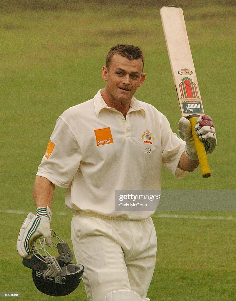 Adam Gilchrist celebrates his century during day three of the first cricket test between Australia and New Zealand held at the Gabba, Brisbane, Australia, DIGITAL IMAGE Mandatory Credit: Chris McGrath/ALLSPORT