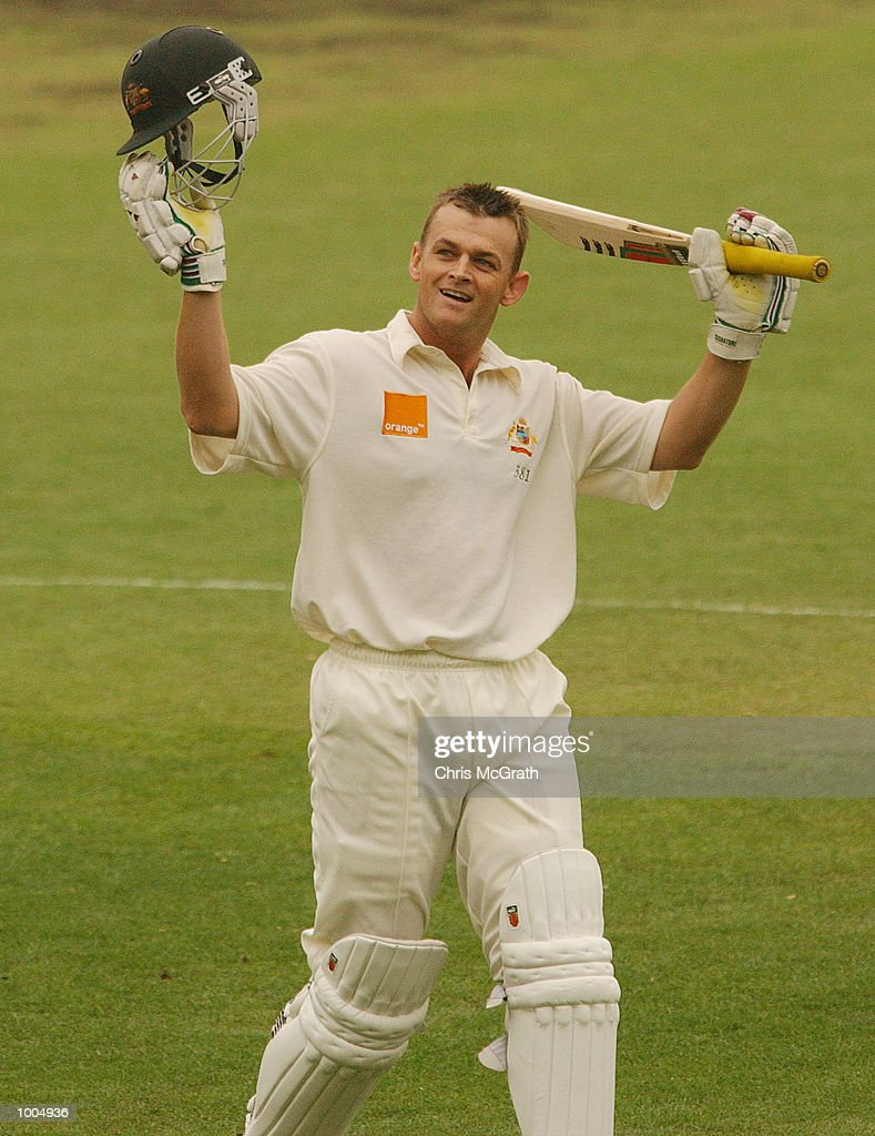 Adam Gilchrist of Australia celebrates after scoring a century during day three of the first cricket test between Australia and New Zealand held at the Gabba, Brisbane, Australia, DIGITAL IMAGE Mandatory Credit: Chris McGrath/ALLSPORT