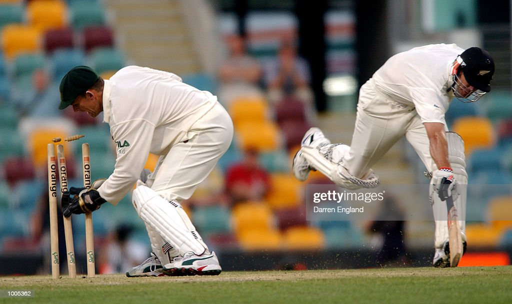 Adam Gilchrist of Australia just fails to run out Chris Cairns of New Zealand during day five of the first Cricket test between Australia and New Zealand played at the Gabba in Brisbane, Australia. DIGITAL IMAGE. Mandatory Credit: Darren England/ALLSPORT