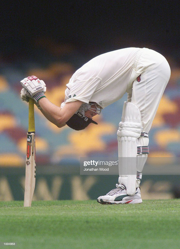 Adam Gilchrist of Australia stretches between overs during the third day of play in the first Test between Australia and New Zealand being played at the Gabba, Brisbane, Australia. DIGITAL IMAGE. Mandatory Credit: Jonathan Wood/ALLSPORT
