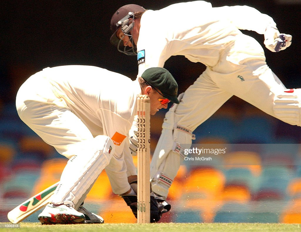 Adam Parore of New Zealand slides in as Adam Gilchrist of Australia waits to take the stumps during day five of the first cricket test between Australia and New Zealand held at the Gabba, Brisbane, Australia, DIGITAL IMAGE Mandatory Credit: Chris McGrath/ALLSPORT