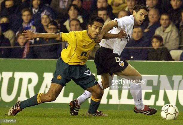 Albelda of Valencia holds off the challenge of Bobby Petta of Celtic during the UEFA Cup Third round first leg match between Valencia and Celtic at...